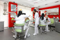 Dentist office dentists at work in modern red dental Royalty Free Stock Photos