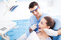 Dentist office male and women in dentist's Stock Photo