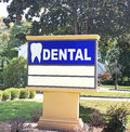 Dentist office sign on a large board with a tooth and the word dental Royalty Free Stock Photography