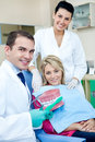 Dentist teaching to brush teeth a female patient how Royalty Free Stock Images