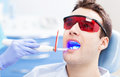 Dentist ultraviolet light equipment young man at office Royalty Free Stock Photos