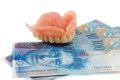 Dentition and the swiss franc Royalty Free Stock Photo