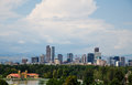Denver skyline past lake in park of colorado beyond a green Royalty Free Stock Photography