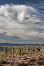 Departing storm monsoon rain clouds dissipate over the sonoran desert in arizona Stock Photography