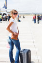 Departure - young woman at an airport Stock Photo