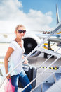 Departure - young woman at an airport Royalty Free Stock Image