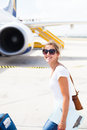 Departure - young woman at an airport Royalty Free Stock Images