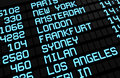 Departures board airport terminal showing international destinations flights to some world s most popular cities business leisure Royalty Free Stock Photography