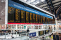 Departures from liverpool street the train board inside station in london Stock Image