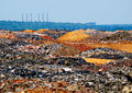 Depleted ore field of dump of iron Royalty Free Stock Photo