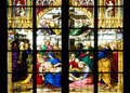 Deposition of christ on stained glass church window depicting from the cross in the koln cathedral germany Stock Photo