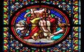 Deposition from the Cross, stained glass window in the Basilica of Saint Clotilde in Paris Royalty Free Stock Photo