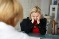 Depressed blonde employee dismissed in office