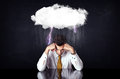 Depressed businessman sitting under a cloud Royalty Free Stock Photo