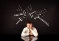 Depressed businessman sitting under hammer marks Royalty Free Stock Photo