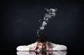 Depressed businessman with smoking head Royalty Free Stock Photo
