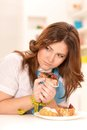 Depressed dieting woman with cake and measuring tape Royalty Free Stock Image