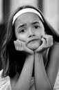 Depressed hispanic girl monochrome portrait of sad little child Royalty Free Stock Photo
