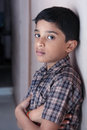 Depressed indian little boy looking at camera Stock Images