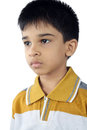 Depressed indian little boy with white background Royalty Free Stock Photography