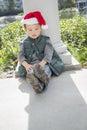 Depressed Mixed Race Boy Wearing Christmas Santa Hat Royalty Free Stock Photo
