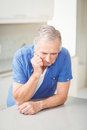Depressed senior man leaning on table Royalty Free Stock Photo