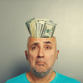 Depressed senior man with money Royalty Free Stock Photo