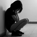 Depressed teenage girl cover the face with her hands Royalty Free Stock Image
