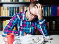 Depressed tired man holding his head Royalty Free Stock Photo