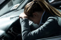Depressed woman in a car Royalty Free Stock Photo