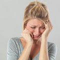Depressed woman in pain expressing regret and sadness Royalty Free Stock Photo