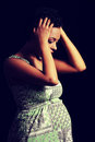 Depression and stress of pregnant woman young against black background Royalty Free Stock Photography