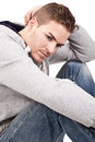 A depressive young man sitting on the floor Stock Photo