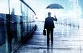 Deprimierter geschäftsmann standing while holding ein regenschirm Stockbild