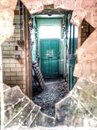 Derelict building a abandoned viewed through a broken window Royalty Free Stock Image