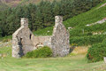 Derelict stone cottage a deserted on a hillside Royalty Free Stock Photo
