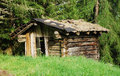 Derelict wooden mountain shack a small hut on a in north east italy Royalty Free Stock Images