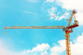 Derrick at construction zone over blue sky Royalty Free Stock Images