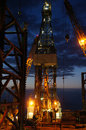 Derrick of jack up drilling rig oil rig at twilight time Stock Image