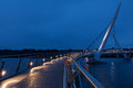 Derry peace bridge at blue hour night cityscape of londonderry northern ireland uk Royalty Free Stock Image