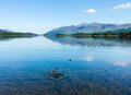 Derwentwater lake district calm water very smooth and on derwent in english is spoiled by splash and ripples from a stone thrown Stock Photography