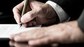 Desaturated image of signing a contract the hands businessman with fountain pen Royalty Free Stock Photo