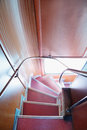 Descend down angular stairway in double decker bus english Stock Image