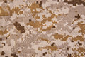 Desert digital camouflage fabric texture background close up Stock Images