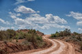 Desert dirt road to paria utah ghost town winding up hill on way Stock Photography