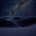 Desert dunes sand in milky way stars night Stock Images