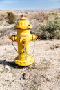 Desert fire hydrant a yellow in the suggests there is water where there is none Stock Photos