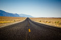 Desert highway desolate through in california Royalty Free Stock Photo