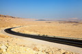 Desert highway road through ramon crater in the negev in israel Royalty Free Stock Photo