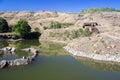 Desert mountain oasis, hut and habitation Royalty Free Stock Photo
